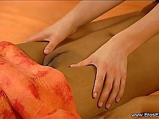 Two Women Engage In Massage
