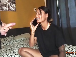 indian slut is on the phone with her boyfriend while cheating on him