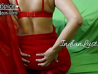Indian girl in red saree sucking dick